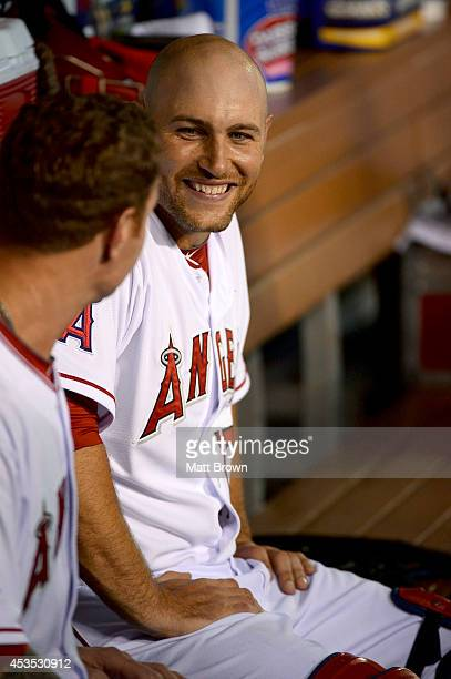 Chris Iannetta of the Los Angeles Angels of Anaheim smiles and talks to Josh Hamilton during the game against the Seattle Mariners at Angel Stadium...