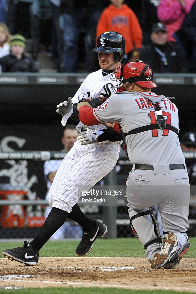<a gi-track='captionPersonalityLinkClicked' href=/galleries/search?phrase=Chris+Iannetta&family=editorial&specificpeople=836137 ng-click='$event.stopPropagation()'>Chris Iannetta</a> #17 of the Los Angeles Angels of Anaheim tags out <a gi-track='captionPersonalityLinkClicked' href=/galleries/search?phrase=Jeff+Keppinger&family=editorial&specificpeople=835796 ng-click='$event.stopPropagation()'>Jeff Keppinger</a> #7 of the Chicago White Sox during the second inning on May 11, 2013 at U.S. Cellular Field in Chicago, Illinois.