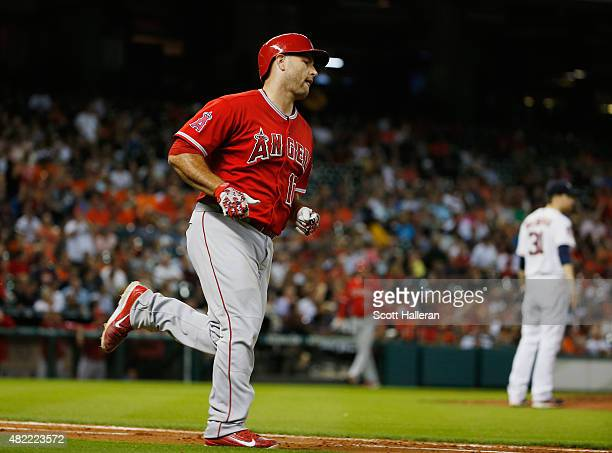 Chris Iannetta of the Los Angeles Angels of Anaheim trots around the bases after hitting a solo home run in the third inning off Collin McHugh of the...