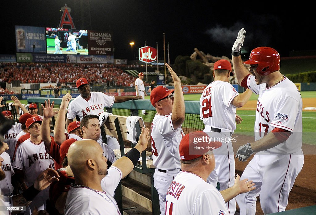 Chris Iannetta #17 of the Los Angeles Angels returns to the dugout after hitting a home run in the third inning against the Kansas City Royals during Game One of the American League Division Series at Angel Stadium of Anaheim on October 2, 2014 in Anaheim, California.