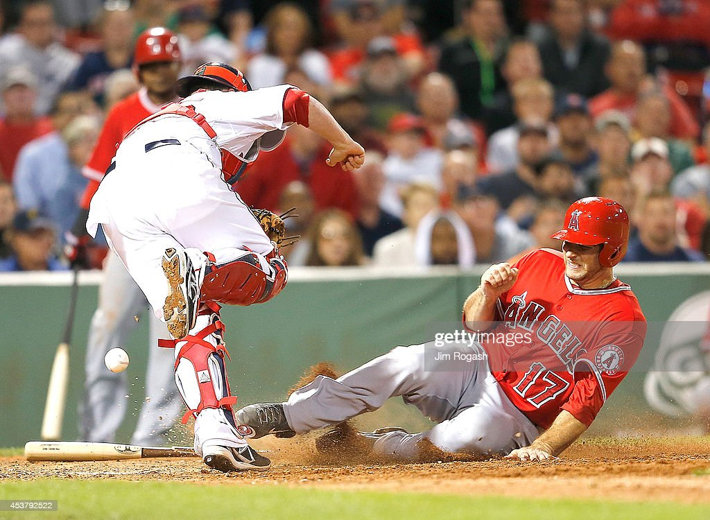 Chris Iannetta #17 of the Los Angeles Angels scores as Christian Vazquez #55 of the Boston Red Sox has trouble handling the throw to the plate in the eighth inning at Fenway Park on August 18, 2014 in Boston, Massachusetts.