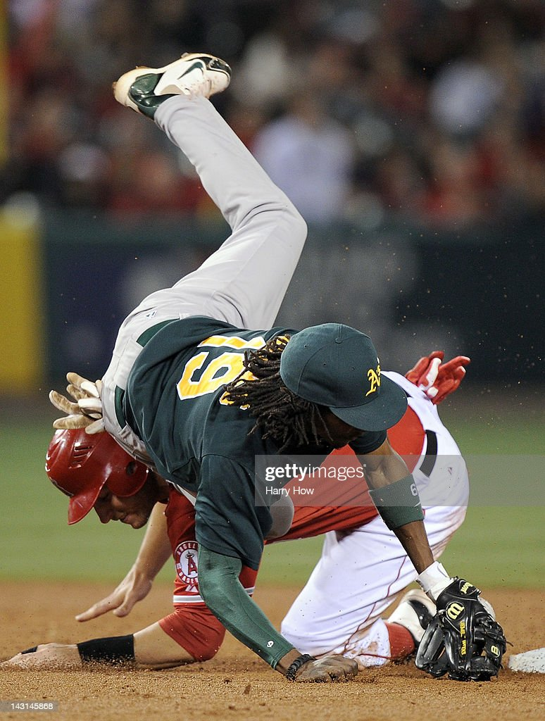 Chris Iannetta #17 of the Los Angeles Angels takes out Jemile Weeks #19 of the Oakland Athletics breaking up a double play during the sixth inning at Angel Stadium of Anaheim on April 19, 2012 in Anaheim, California.