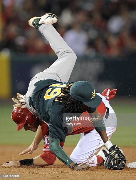 Chris Iannetta of the Los Angeles Angels takes out Jemile Weeks of the Oakland Athletics breaking up a double play during the sixth inning at Angel...