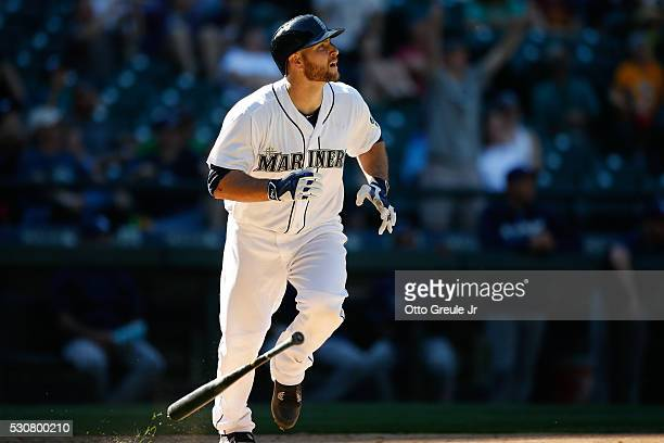 Chris Iannetta of the Seattle Mariners watches his gamewinning walkoff home run to defeat the Tampa Bay Rays 65 in the eleventh inning at Safeco...