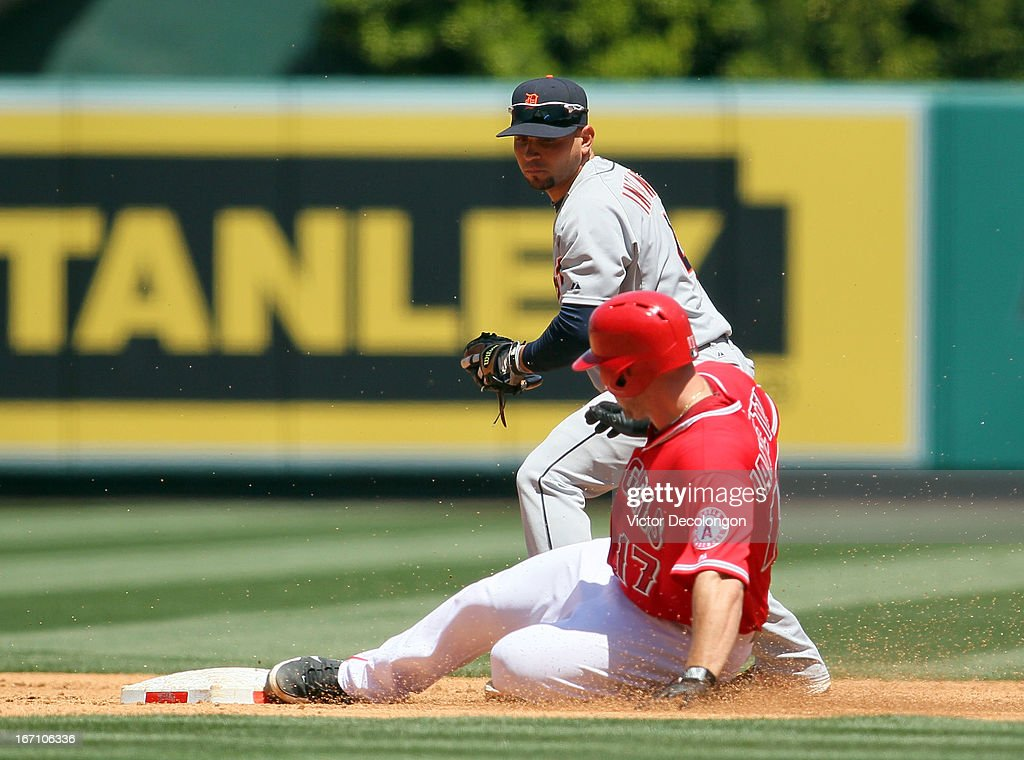 Chris Iannetta #17of the Los Angeles Angels of Anaheim slides into second base before the tag of Omar Infante #4 of the Detroit Tigers in the second inning during the MLB game at Angel Stadium of Anaheim on April 20, 2013 in Anaheim, California. Iannetta hit a two-out double. The Angels defeated the Tigers 10-0.