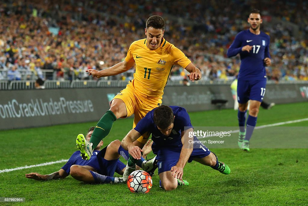 <a gi-track='captionPersonalityLinkClicked' href=/galleries/search?phrase=Chris+Ikonomidis&family=editorial&specificpeople=14096211 ng-click='$event.stopPropagation()'>Chris Ikonomidis</a> of the Socceroos is tackled by <a gi-track='captionPersonalityLinkClicked' href=/galleries/search?phrase=Sokratis+Papastathopoulos+-+Soccer+Player&family=editorial&specificpeople=4426771 ng-click='$event.stopPropagation()'>Sokratis Papastathopoulos</a> of Greece during the international friendly match between the Australian Socceroos and Greece at ANZ Stadium on June 4, 2016 in Sydney, Australia.