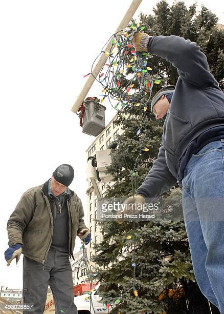 Chris Ingram and Jay AshCuthbert who work for the Portland Department of Public Services untangle and coil up strings of up to 2000 lights from the...