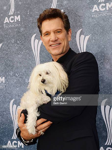 Chris Isaak and his dog Rodney attend the 9th Annual ACM Honors at Ryman Auditorium on September 1 2015 in Nashville Tennessee
