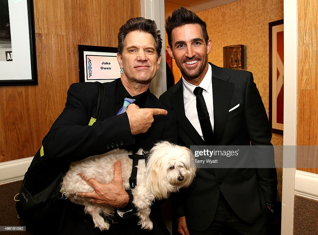 Chris Isaak and Jake Owen pose backstage during the 9th Annual ACM Honors at the Ryman Auditorium on September 1 2015 in Nashville Tennessee
