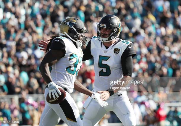 Chris Ivory and Blake Bortles of the Jacksonville Jaguars celebrate after Ivory ran for a 22yard touchdown in the first half of their game against...