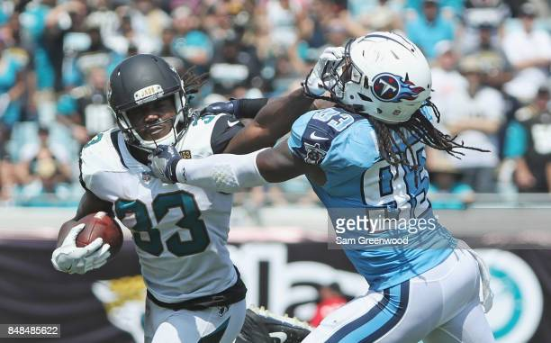 Chris Ivory of the Jacksonville Jaguars fights off the tackle of Eric Walden of the Tennessee Titans during the first half of their game at EverBank...