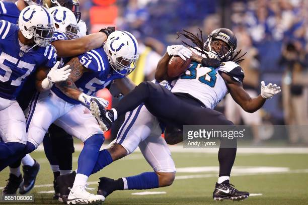 Chris Ivory of the Jacksonville Jaguars is tackled by Antonio Morrison of the Indianapolis Colts during the first half at Lucas Oil Stadium on...