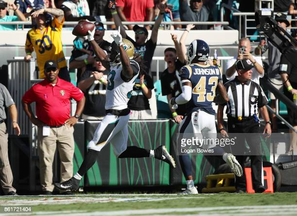 Chris Ivory of the Jacksonville Jaguars runs with the football for a 22yard touchdown in front of John Johnson III of the Los Angeles Rams during the...
