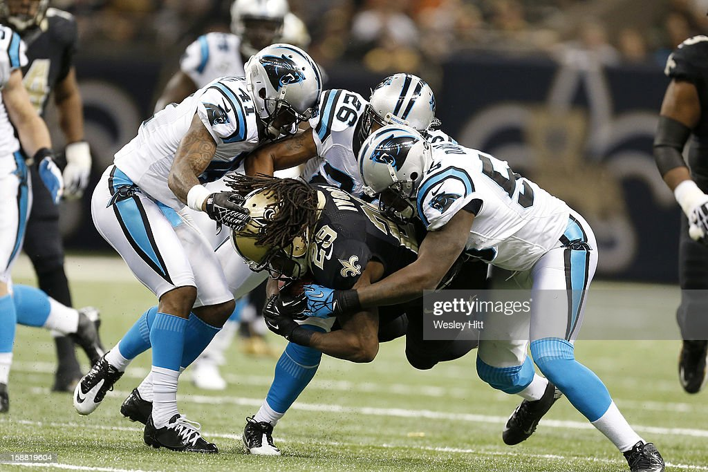 Chris Ivory #29 of the New Orleans Saints is tackled by <a gi-track='captionPersonalityLinkClicked' href=/galleries/search?phrase=Captain+Munnerlyn&family=editorial&specificpeople=4063410 ng-click='$event.stopPropagation()'>Captain Munnerlyn</a> #41, D.J. Campbell #26 and Thomas Davis #58 of the Carolina Panthers at Mercedes-Benz Superdome on December 30, 2012 in New Orleans, Louisiana. The Panthers defeated the Saints 44-38.