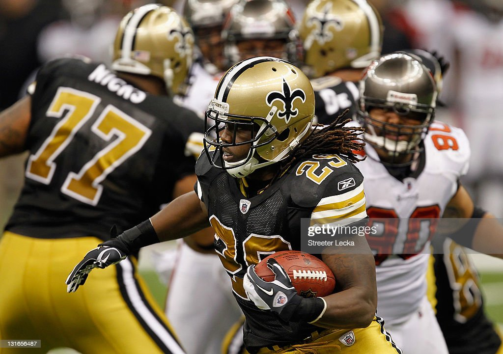 Chris Ivory #29 of the New Orleans Saints runs with the ball against the Tampa Bay Buccaneers during their game at Mercedes-Benz Superdome on November 6, 2011 in New Orleans, Louisiana.