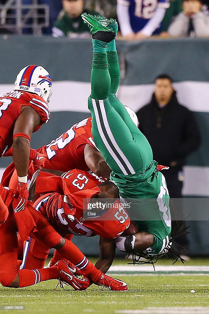 Chris Ivory #33 of the New York Jets is tackled by Nigel Bradham #53 of the Buffalo Bills during the third quarter at MetLife Stadium on November 12, 2015 in East Rutherford, New Jersey. The Buffalo Bills defeated the New York Jets 22-17.