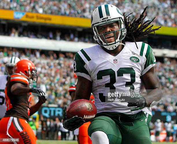 Chris Ivory of the New York Jets reacts after scoring a touchdown against the Cleveland Browns during the second quarter of a game at MetLife Stadium...