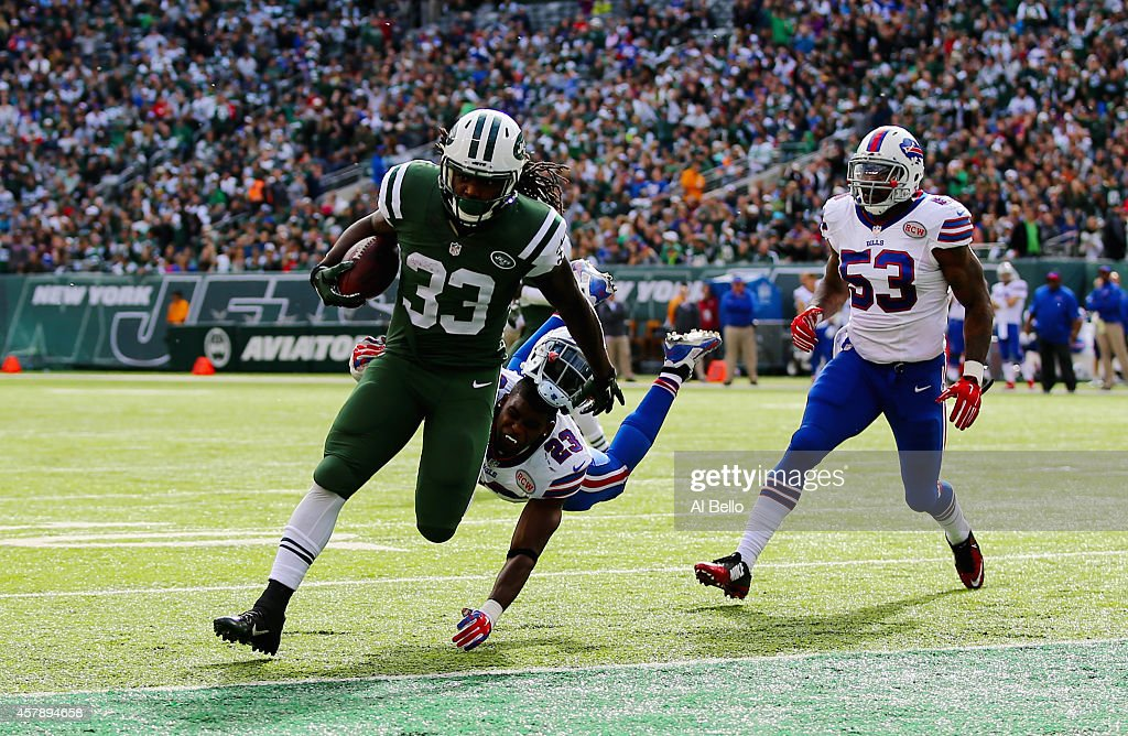 Chris Ivory #33 of the New York Jets scores a touchdown against Aaron Williams #23 of the Buffalo Bills and Nigel Bradham #53 in the second quarter at MetLife Stadium on October 26, 2014 in East Rutherford, New Jersey.