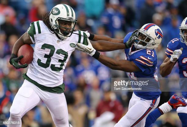 Chris Ivory of the New York Jets stiff arms Leodis McKelvin of the Buffalo Bills during NFL game action at Ralph Wilson Stadium on November 17 2013...