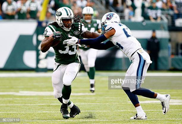 Chris Ivory of the New York Jets tries to avoid the tackle of Coty Sensabaugh of the Tennessee Titans in the second quarter during their game at...