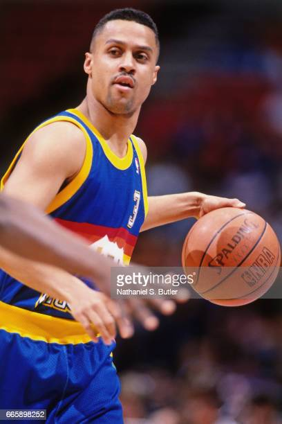 Chris Jackson of the Denver Nuggets dribbles against the New Jersey Nets during a game played circa 1993 at the Brendan Byrne Arena in East...