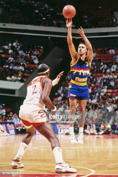 Chris Jackson of the Denver Nuggets shoots against the Atlanta Hawks during a game played circa 1990 at the Omni in Atlanta Georgia NOTE TO USER User...