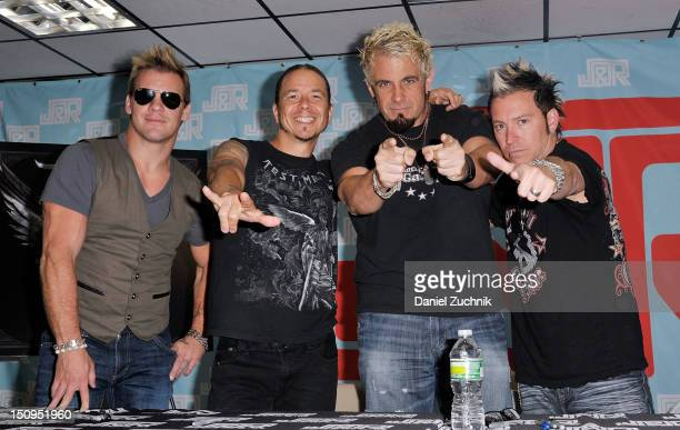 Chris Jericho Rich Ward Frank Fontsere and Billy Grey of Fozzy visit JR Music World on August 29 2012 in New York City