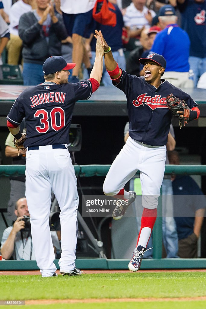 Chris Johnson #30 and Francisco Lindor #12 of the Cleveland Indians celebrate after the Indians turned a double play to end the top of the eighth inning against the New York Yankees at Progressive Field on August 12, 2015 in Cleveland, Ohio.