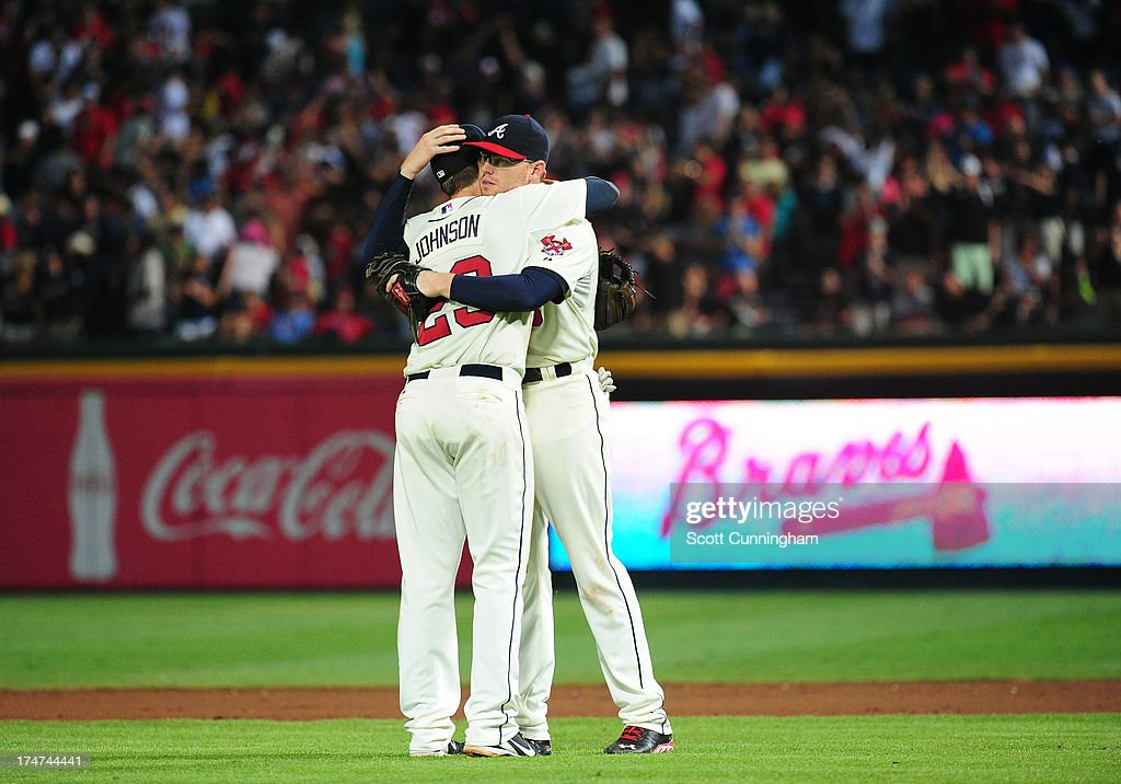 Chris Johnson #23 and <a gi-track='captionPersonalityLinkClicked' href=/galleries/search?phrase=Freddie+Freeman&family=editorial&specificpeople=5743987 ng-click='$event.stopPropagation()'>Freddie Freeman</a> #5 of the Atlanta Braves celebrate after the game against the St. Louis Cardinals at Turner Field on July 28, 2013 in Atlanta, Georgia.