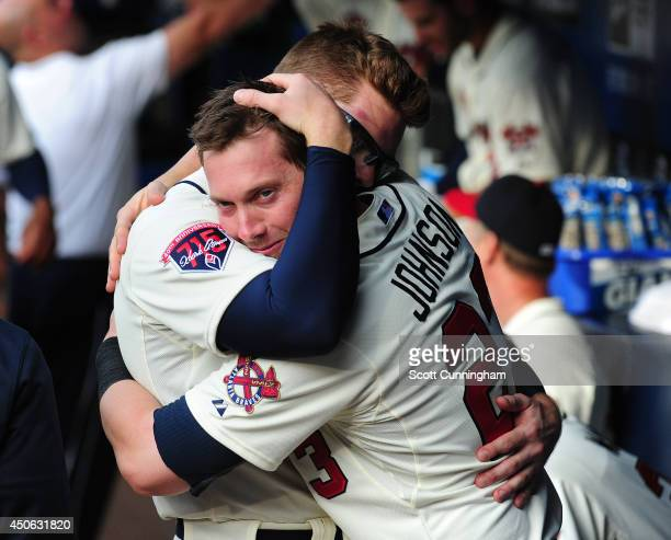 Chris Johnson and Freddie Freeman of the Atlanta Braves embrace before the game against the Los Angeles Angels of Anaheim at Turner Field on June 14...