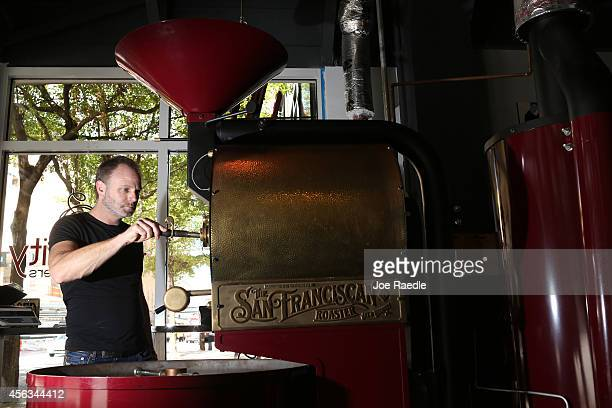 Chris Johnson checks on coffee beans as they are roasted at his coffee house Eternity Coffee Roasters during National Coffee Day on September 29 2014...