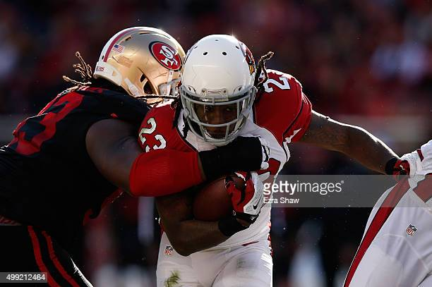 Chris Johnson of the Arizona Cardinals is hit by Ian Williams of the San Francisco 49ers at the line of scrimmage during their NFL game at Levi's...