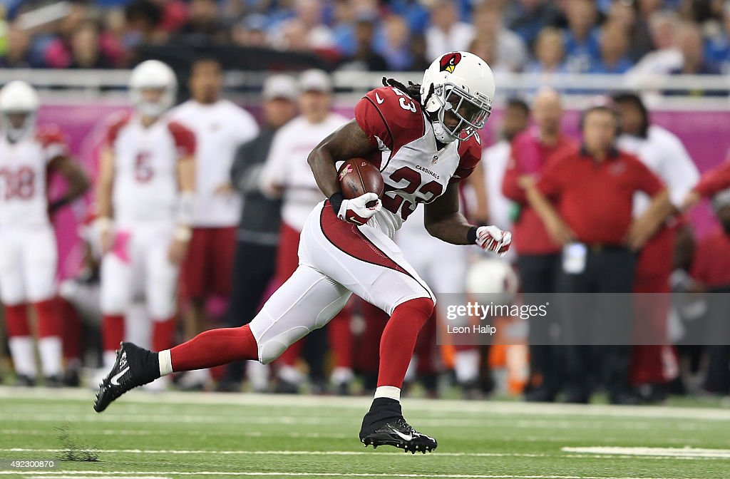 Chris Johnson of the Arizona Cardinals runs the ball in the second quarter while playing the Detroit Lions on October 11 2015 at Ford Field in...