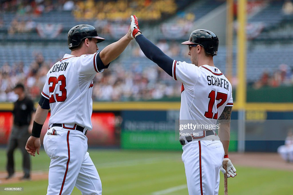 Chris Johnson #23 of the Atlanta Braves celebrates with <a gi-track='captionPersonalityLinkClicked' href=/galleries/search?phrase=Jordan+Schafer&family=editorial&specificpeople=4958028 ng-click='$event.stopPropagation()'>Jordan Schafer</a> #17 against the Philadelphia Phillies during the first inning at Turner Field on June 18, 2014 in Atlanta, Georgia.