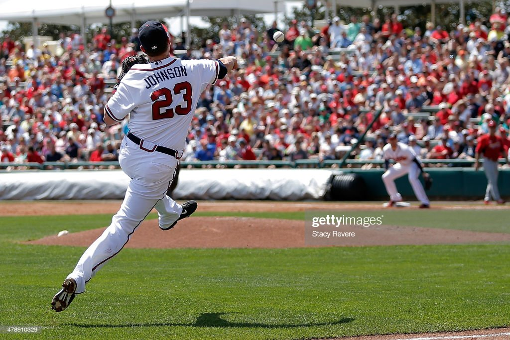 Chris Johnson of the Atlanta Braves makes a throw to first base in the third inning of a game against the St Louis Cardinals at Champion Stadium on...