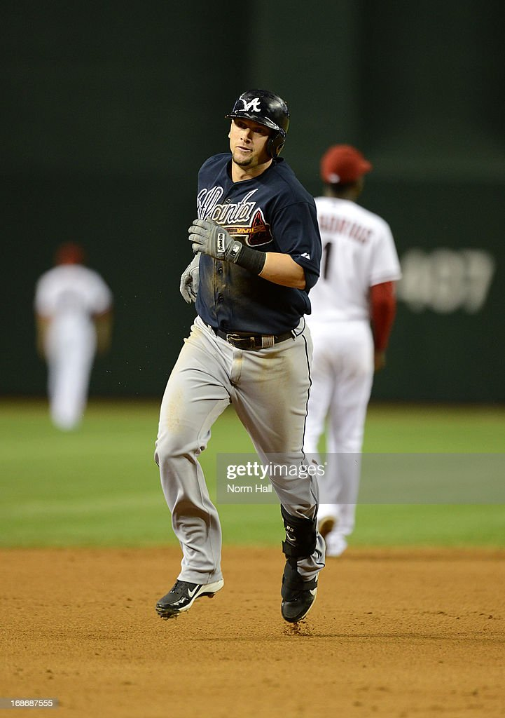 Chris Johnson #23 of the Atlanta Braves rounds the bases after hitting a home run against the Arizona Diamondbacks at Chase Field on May 13, 2013 in Phoenix, Arizona.