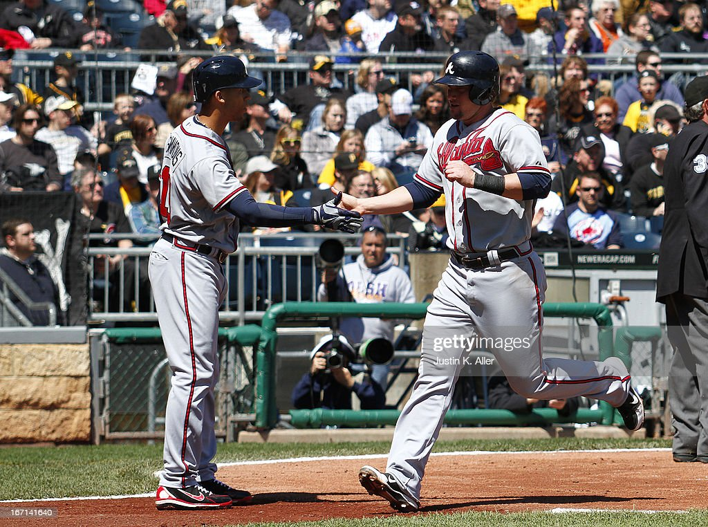 Chris Johnson #23 of the Atlanta Braves scores on an RBI sinlge in the second inning against the Pittsburgh Pirates during the game on April 21, 2013 at PNC Park in Pittsburgh, Pennsylvania.