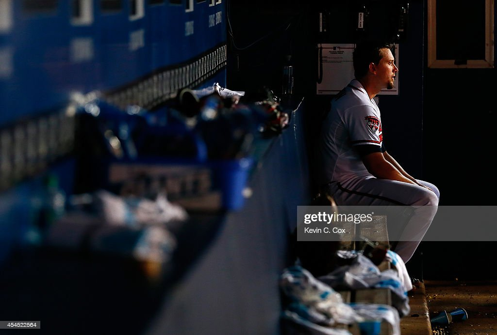 Chris Johnson #23 of the Atlanta Braves sits in the dugout after their 4-0 shutout loss to the Philadelphia Phillies at Turner Field on September 2, 2014 in Atlanta, Georgia.