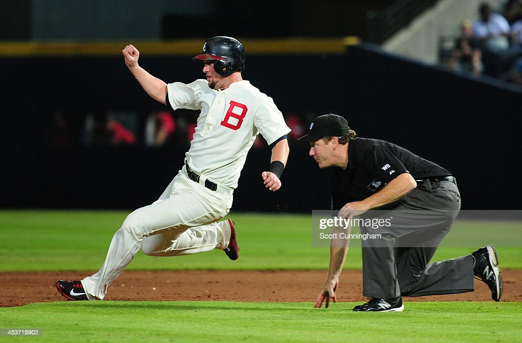 Chris Johnson of the Atlanta Braves slides in to second base on a sixth inning wild pitch against the Oakland Athletics at Turner Field on August 16...