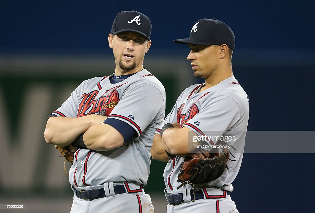 Chris Johnson of the Atlanta Braves talks to Jace Peterson during a pitching change in the seventh inning during MLB game action against the Toronto...