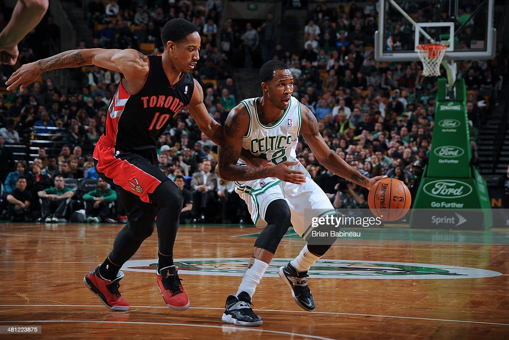 <a gi-track='captionPersonalityLinkClicked' href=/galleries/search?phrase=Chris+Johnson+-+Basketball+Player+-+Shooting+Guard&family=editorial&specificpeople=11492905 ng-click='$event.stopPropagation()'>Chris Johnson</a> #12 of the Boston Celtics drives against the Toronto Raptors on March 26, 2014 at the TD Garden in Boston, Massachusetts.