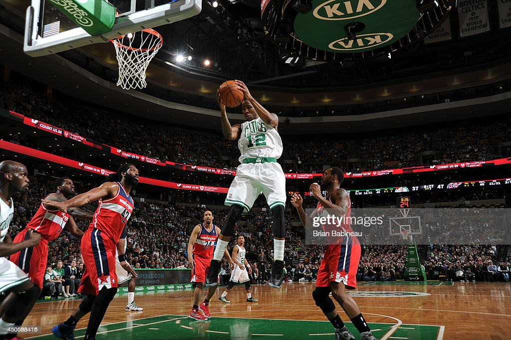 Chris Johnson #12 of the Boston Celtics rebounds against the Washington Wizards on April 16, 2014 at the TD Garden in Boston, Massachusetts.