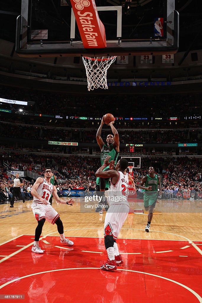 Chris Johnson #12 of the Boston Celtics takes a shot against the Chicago Bulls on March 31, 2014 at the United Center in Chicago, Illinois.