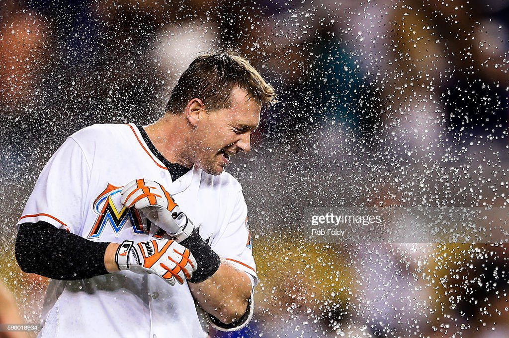 Chris Johnson of the Miami Marlins celebrates with teammates after hitting a walkoff double to end the game against the San Diego Padres at Marlins...