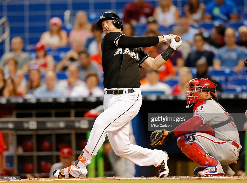 Chris Johnson of the Miami Marlins doubles in front of catcher Carlos Ruiz of the Philadelphia Phillies during the second inning of a game at Marlins...