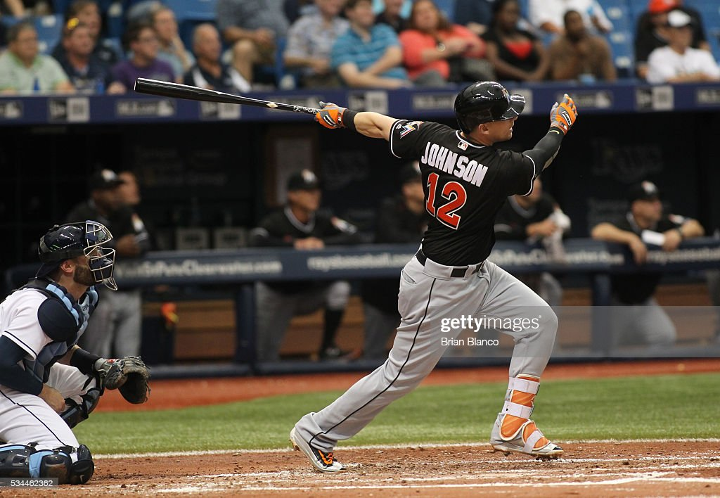 Chris Johnson of the Miami Marlins hits a tworun home run in front of catcher Curt Casali of the Tampa Bay Rays during the third inning of a game on...