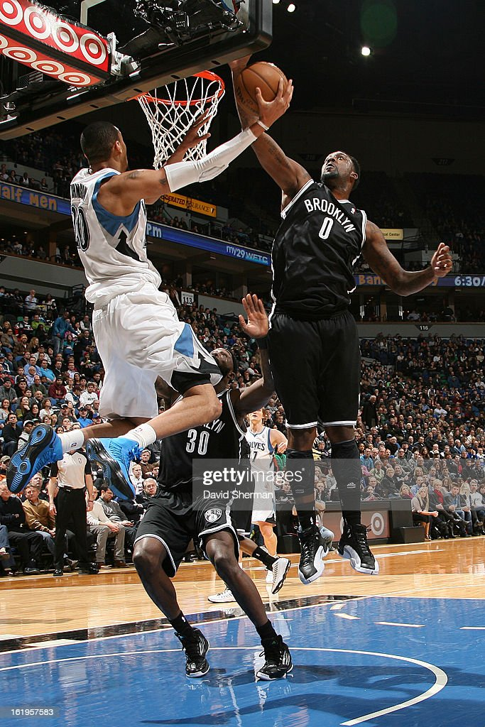 Chris Johnson #20 of the Minnesota Timberwolves drives to the basket against the Brooklyn Nets on January 23, 2013 at Target Center in Minneapolis, Minnesota.