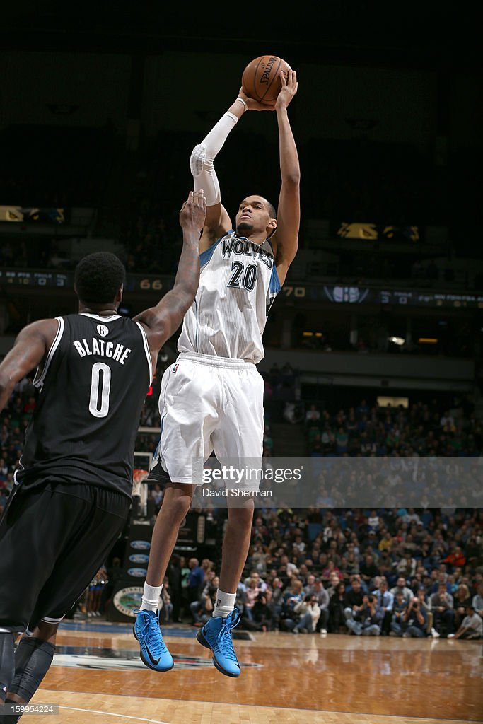 Chris Johnson #20 of the Minnesota Timberwolves goes for a jump shot against Andray Blatche #0 of the Brooklyn Nets during the game between the Minnesota Timberwolves and the Brooklyn Nets on January 23, 2013 at Target Center in Minneapolis, Minnesota.