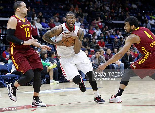 Chris Johnson of the Rio Grande Valley Vipers takes the ball to the basket against Antoine Aguido left and Chris Crawford right of the Canton Charge...