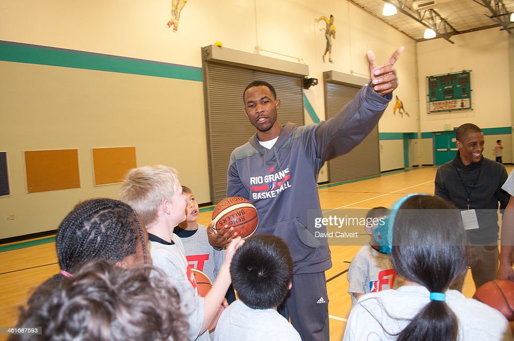 Chris Johnson of the Rio Grande Valley Vipers works with kids at the Boys & Girls Club of the Truckee Meadows during the NBA D-League FIT clinic part of the 2014 NBA D-League Showcase on January 7, 2014 in Reno, Nevada.